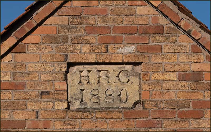 HRC plaque on end of barn