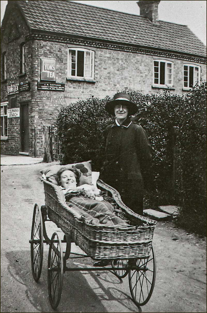 Mrs Edith Allen and daughter on Church Street outside Eastwood's shop