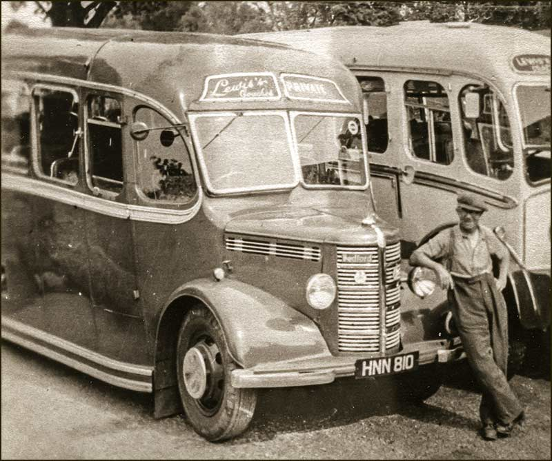 J. Lewis himself with two of his buses